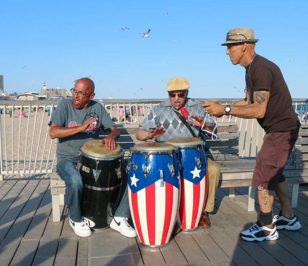 Drummers playing on the pier at Coney Island