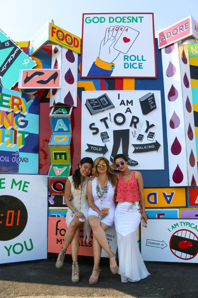 "Girls posing in front of street art mural by Steve ""ESPO"" Powers during the mermaid parade in Coney Island"
