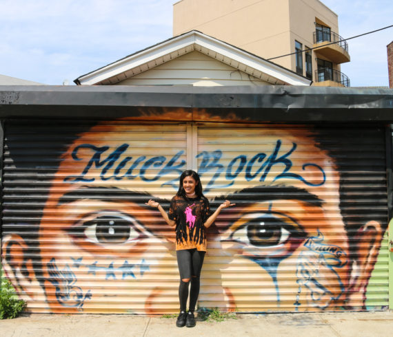 Model in front of Frida Kahlo street art mural by Jules Muck at Welling Court in Astoria, Queens