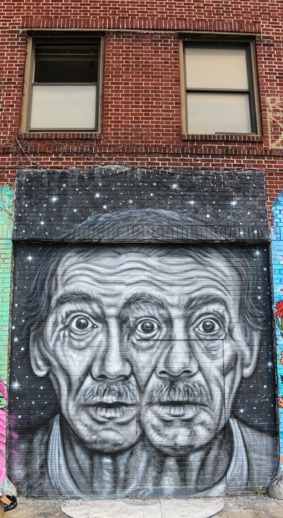 Street art mural by Pyramid Oracle at Welling Court in Astoria Queens