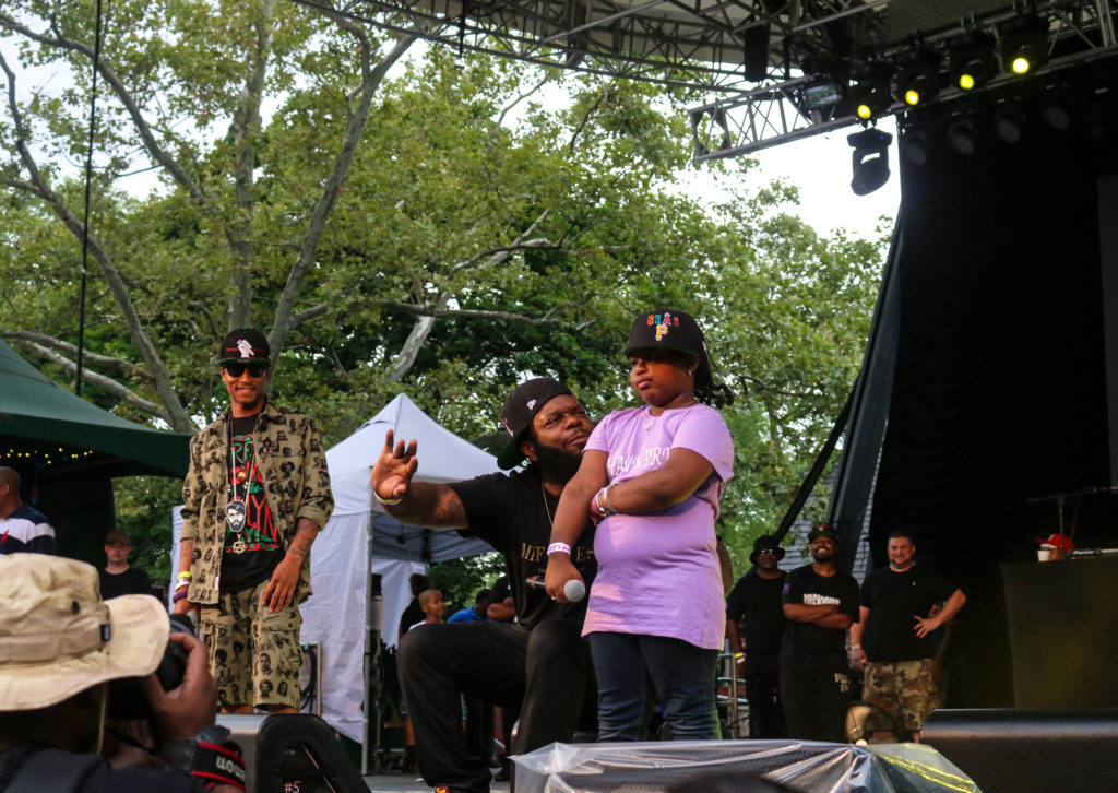 Smif-N-Wessun with Sean Price's daughter at the Rock Steady Crew 39th Anniversary show in Central Park