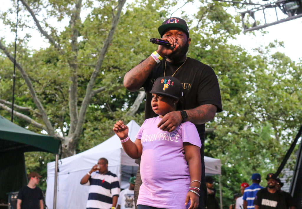 Tek from Smif-N-Wessun with Sean Price's daughter at the Rock Steady Crew 39th Anniversary show in Central Park