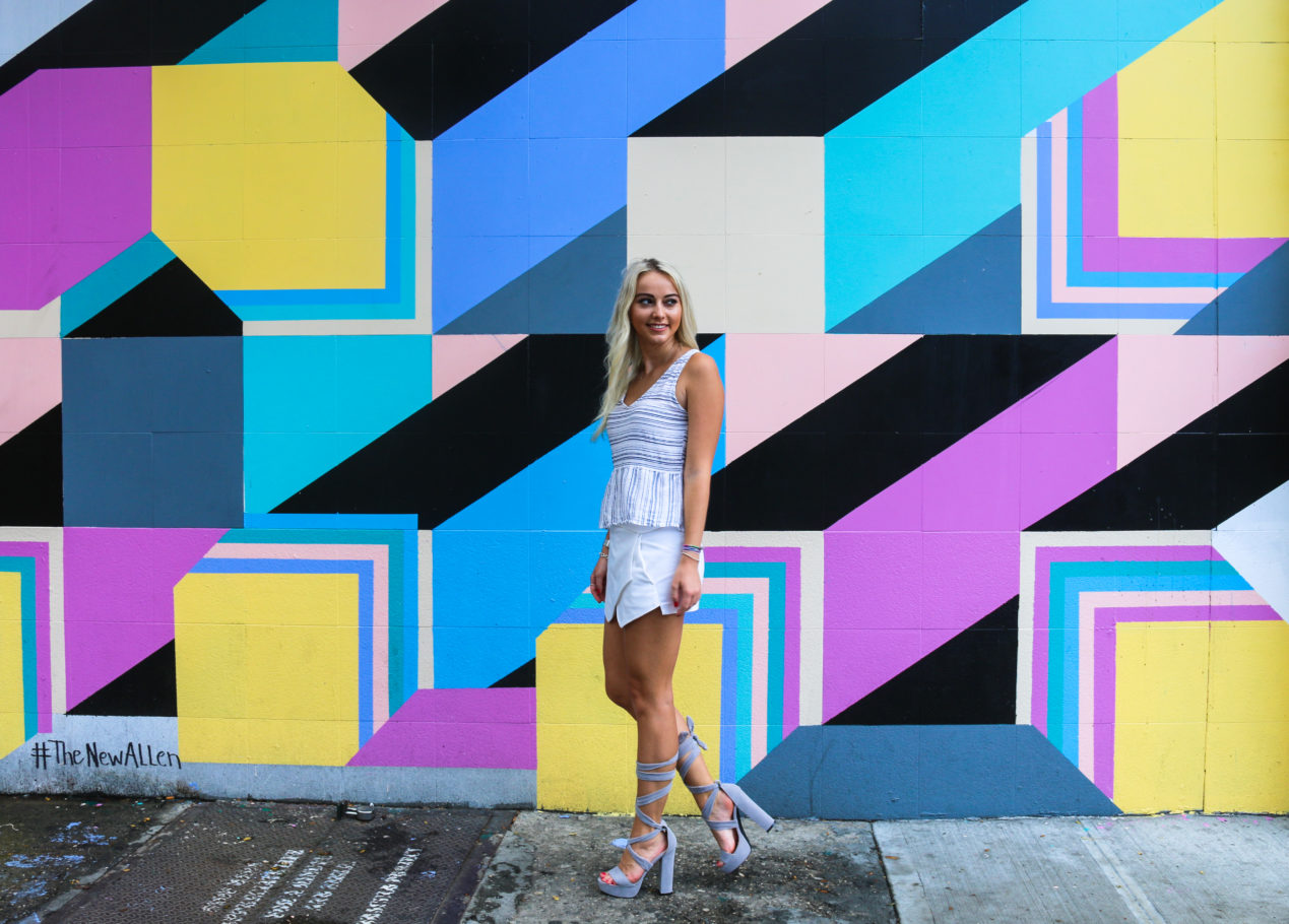 Fashion blogger in front of street art mural by Edward Granger on the Lower East Side of Manhattan